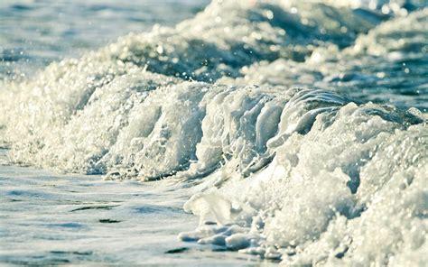 frozen waves wallpaper water blue ocean sea white waves frozen foam bubbles bokeh
