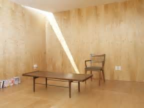 Lone slit of sunlight streaks down into the plywood paneled monk