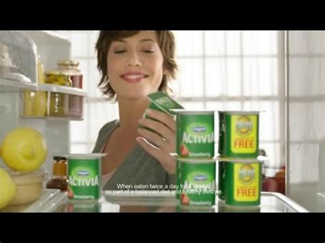 a new year television ad features a in a parade tv commercial dannon activia happy new year start