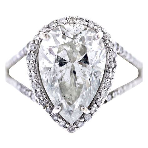 pear shaped halo style pave engagement ring at 1stdibs