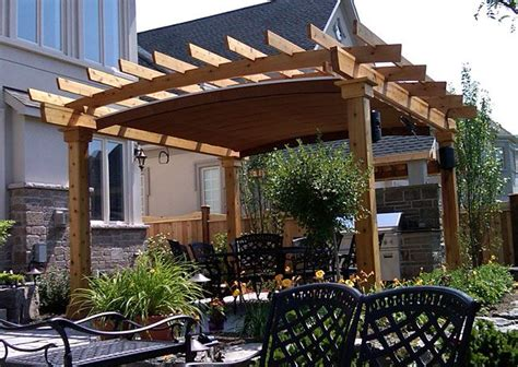 A Retractable Canopy System Custom Fitted Into Arched Pergola Cover Ideas