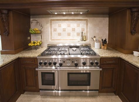 Flat top gas stove kitchen traditional with appliances cabinetry country kitchen