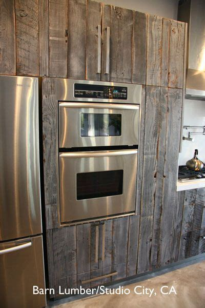 used wood kitchen cabinets salvaged barn wood used to reface ikea cabinets rustic