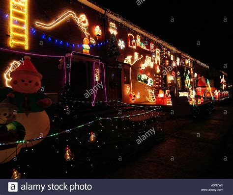 terrace houses decorated with lots of christmas lights at