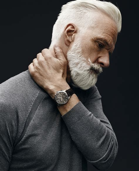 60 year old man with a brush cut handsome gray haired and bearded male model general
