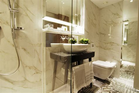 Small Bathrooms Design Ideas porcel thin carrera tiles chosen by prestigious sherlock
