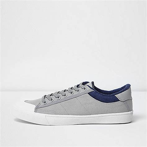 grey canvas plimsolls trainers shoes boots