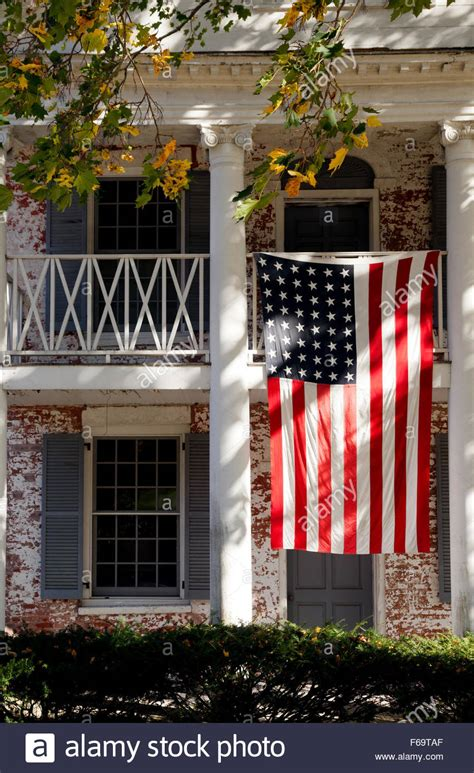 hanging flag on house american flag hanging outside a house in salisbury connecticut ct stock photo