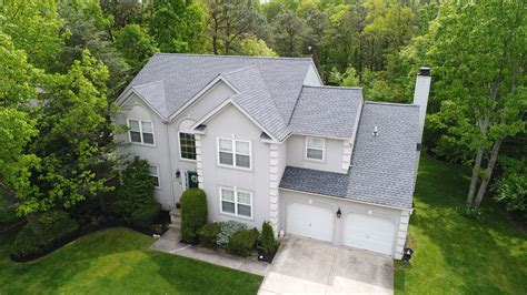timberline pewter grey shingle with white siding gaf timberline hd lifetime roofing system with pewter gray