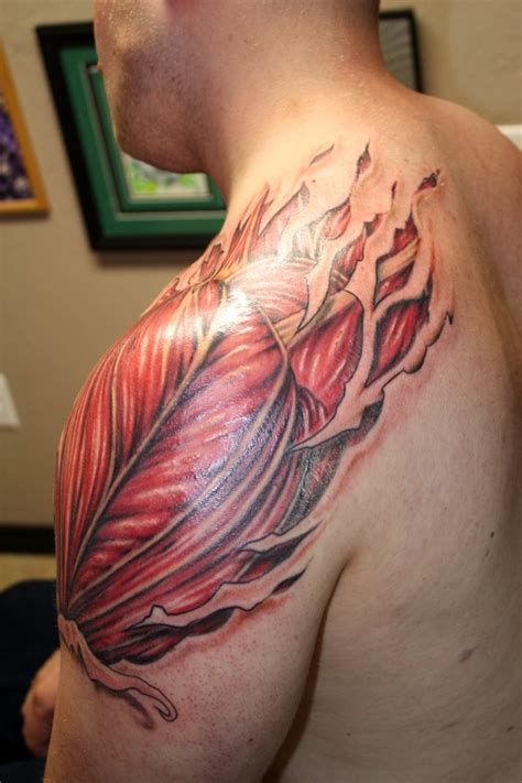 muscle tattoo ripped skin on forearm