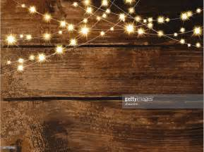 horizontal wooden background with string lights and jars vector getty images