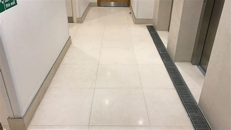 Stone Floor Restoration   Regina House, London   Renue UK