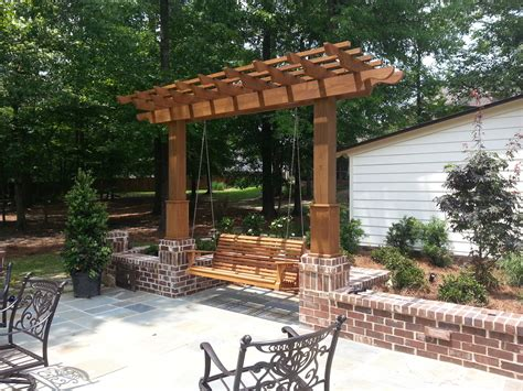 trellis with swing ivory iris hardscape and planting landscape design studio