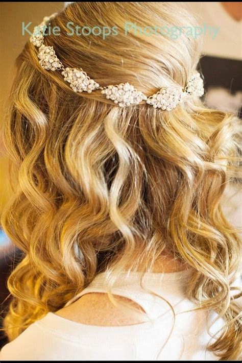 down hairstyles with headbands half up half down wavy bridal hairstyle but with flowers