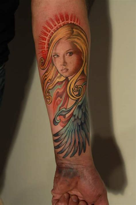 colored angel tattoo colored ink on left forearm tattooshunt