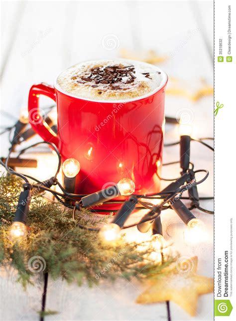 winter coffee   red mug  christmas lights  cookies stock photography image