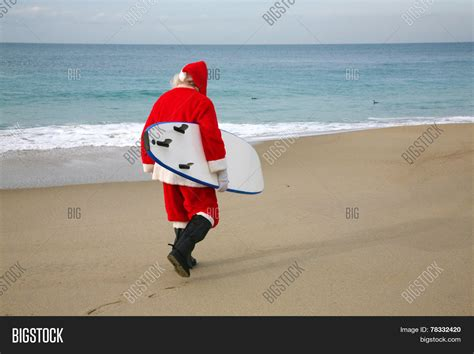 surfing santa claus lonely santa image photo bigstock