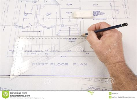drawing up house plans architect drawing up plans for a house stock photo image 4794610