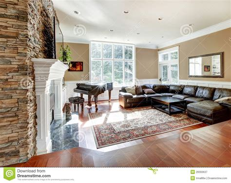 Bright Luxury Living Room With Stone Fireplace And Cherry