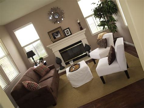 and taupe living room ideas family room brown sofa living rooms brown sofa white chairs taupe walls white