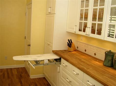 Built In Ironing Board Drawer by Ironing Board Cabinet Extensions For Organized Laundry Rooms
