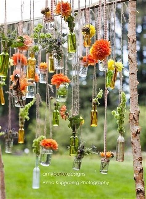 Wedding Arch With Jars by Hanging Salvaged Bottles And Jars On Chuppah At Wedding