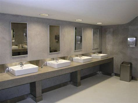 traditional commercial bathroom with framed mirrors