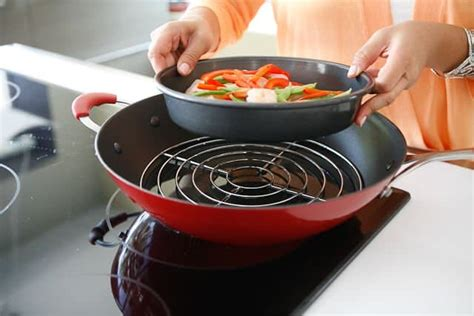 wok steaming rack introducing steamy kitchen wok and rice bran oil steamy