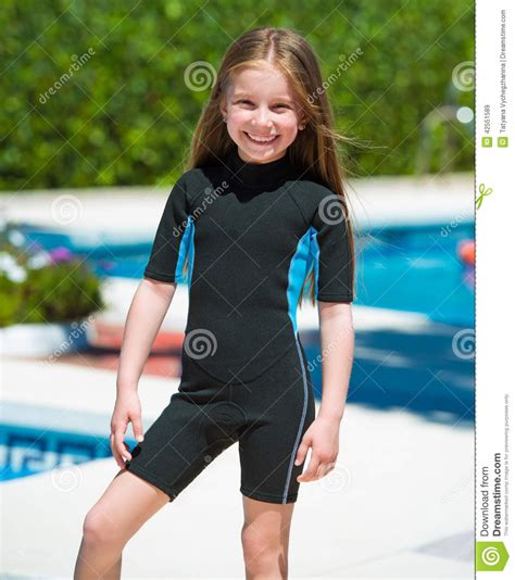 small teen happy little girl in a wetsuit stock image image 42551589
