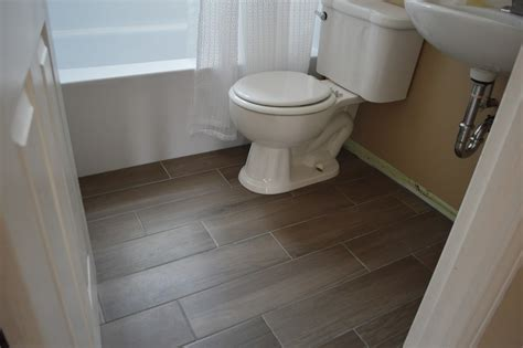 tiling on wooden floors bathroom 27 ideas and pictures of wood or tile baseboard in bathroom