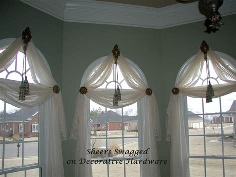 round window curtains sheers on holdbacks and rosettes eclectic window