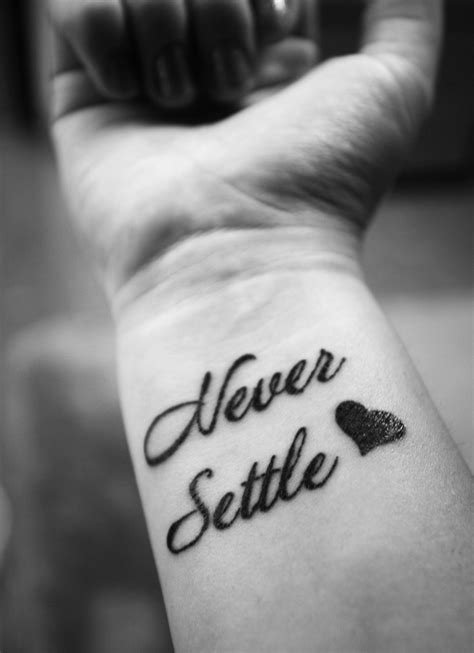 wrist tattoo experience my quot never settle quot wrist tattoos