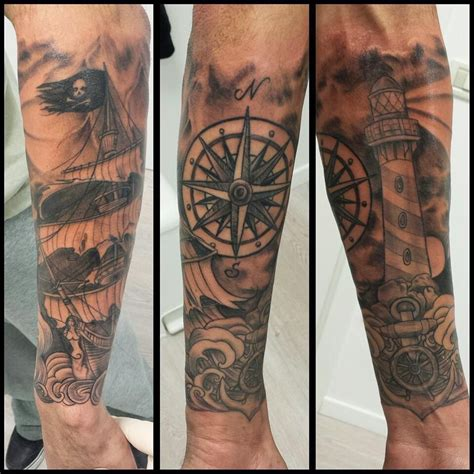 compass lighthouse tattoo lighthouse pirate ship compass done by domino effect
