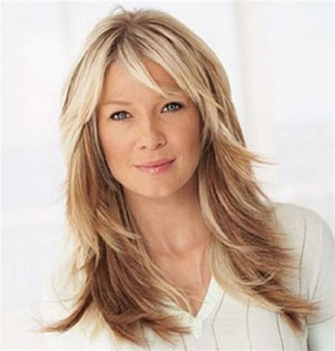 long haircuts with bangs and layers over 40 long layered haircuts for women over 40 wavy layered