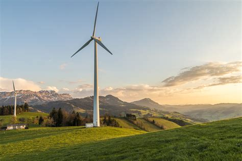 windmill energy  green grass field  stock photo