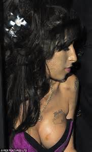 images of love bites on breast amy winehouse is pretty in purple for first red carpet