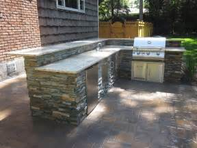 outdoor kitchen with bar top granite countertop veneered