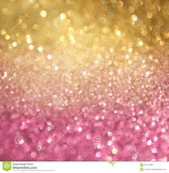 gold and pink abstract bokeh lights defocused background royalty free