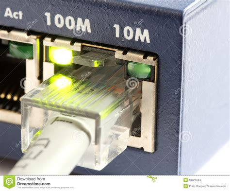 network switch with grey ethernet cable stock images