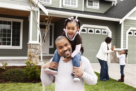 Family In Front Of House by Refinancing Solutions Ameris Bank