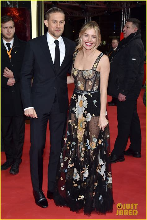 charlie hunnam and sienna miller spotted in botanic robert pattinson charlie hunnam look suave at lost city