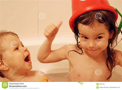 bathtub sisters sisters playing stock images image 5357134