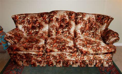 ugliest sofa ever across time and space with orange and brown and flowers
