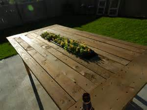 white outdoor pallet table with recessed planter box