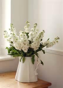 white matthiolas in white ceramic pitcher peachy wedding