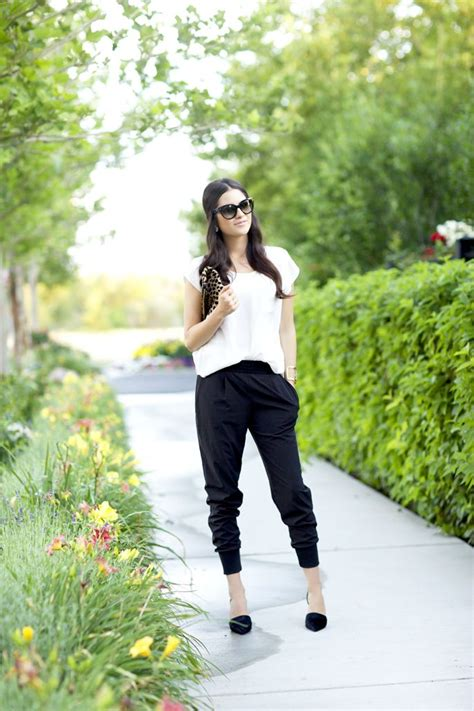 how a woman should dress on a friday night at fifty how to pull off jogger pants at the office glam radar