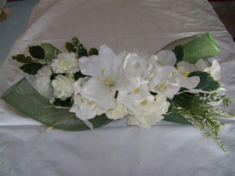 lavorare da casa confezionando oggetti centrotavola fiore di seta immagini
