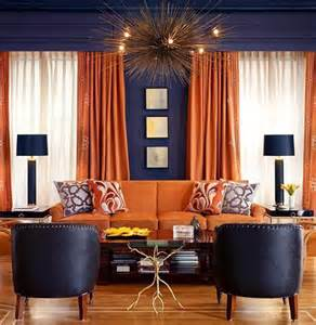 orange curtains and upholstery against dark grey walls is an excellent pairing that reads both