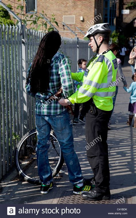 Search Arrested Black Being Arrested After Stop And Search By A Officer Stock Photo