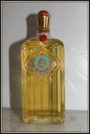 perfume bottle with holly on the scent vintage